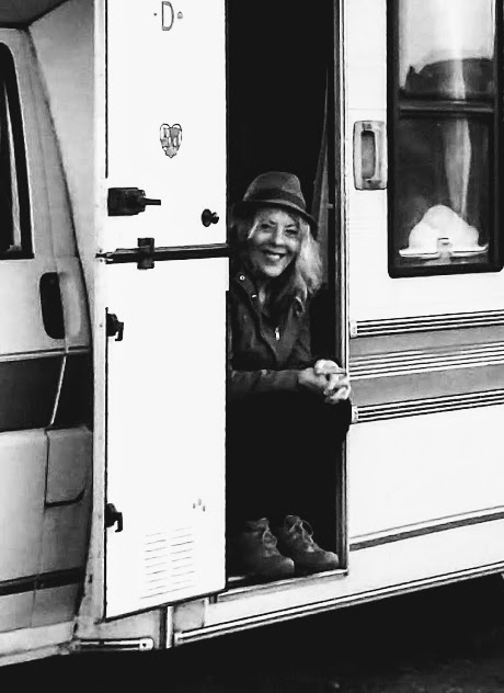 Hobo Trudi sitting smiling in hab door of motorhome