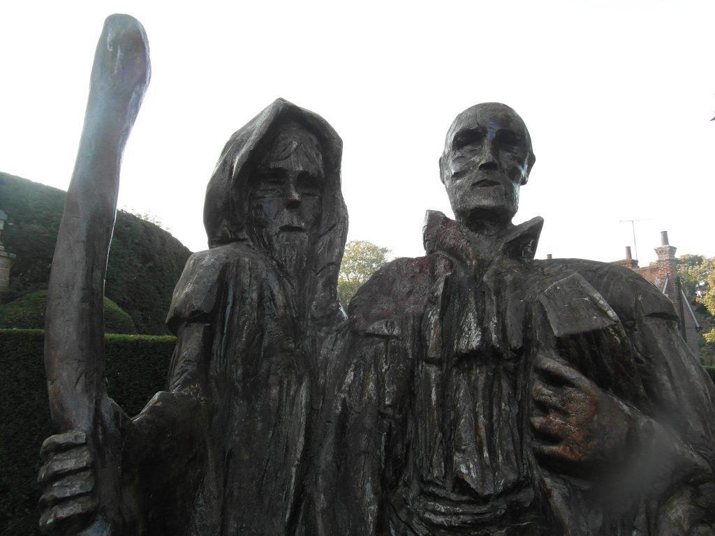 wooden statue of two pilgrims