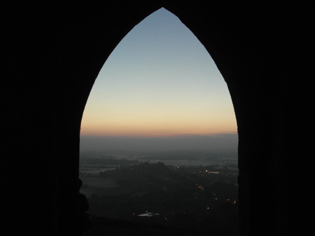 view of Glastonbury from the Tor at dusk