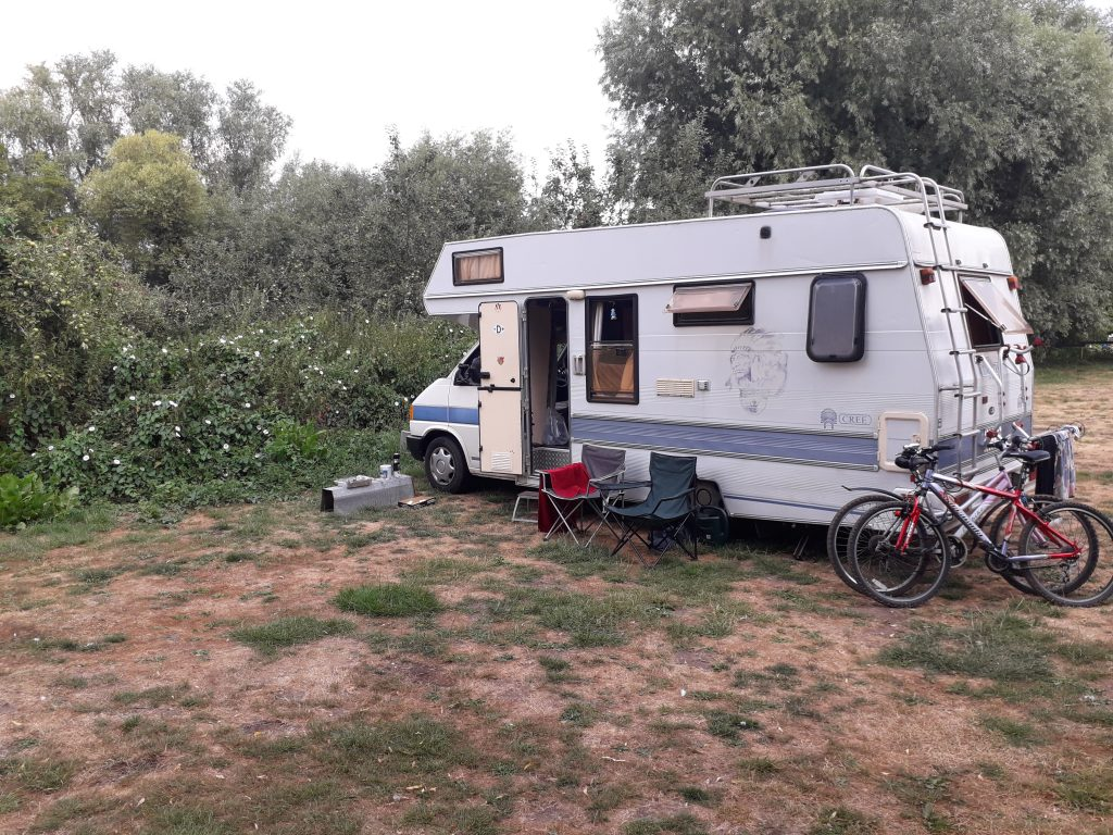 a VW T4 motorhome at one of the more natural UK campsites