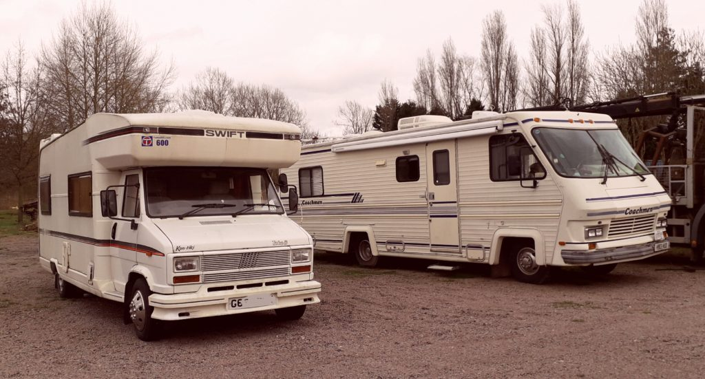 two vintage motorhomes: a Fiat and a Coachmen
