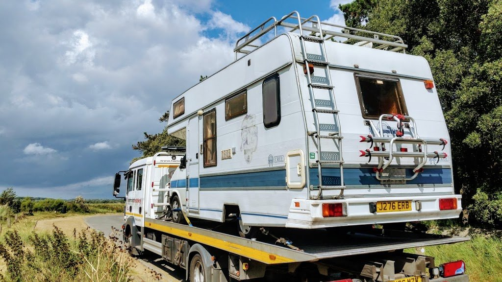 VW T4 motorhome in the back of a tow truck