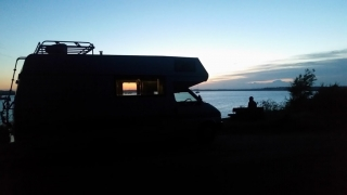 VW motorhome by the river Deben in Suffolk at sunset