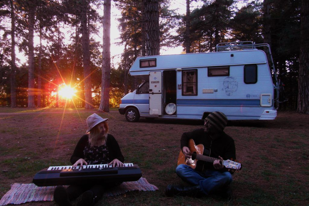 Motorhome Hobos making music in the sunset