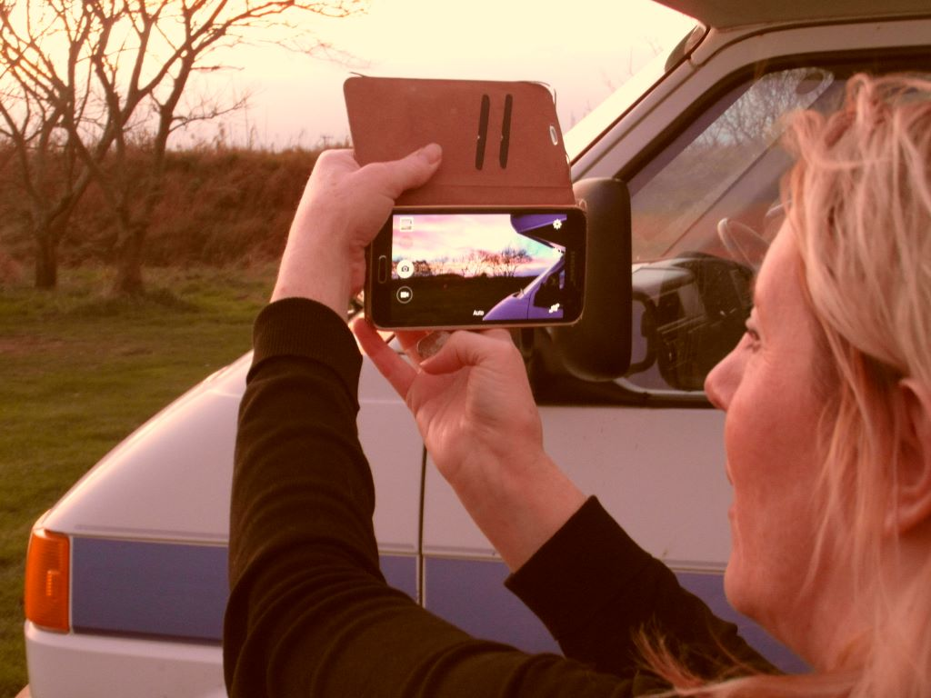 Trudi taking sunset picture at Southwold, Suffolk