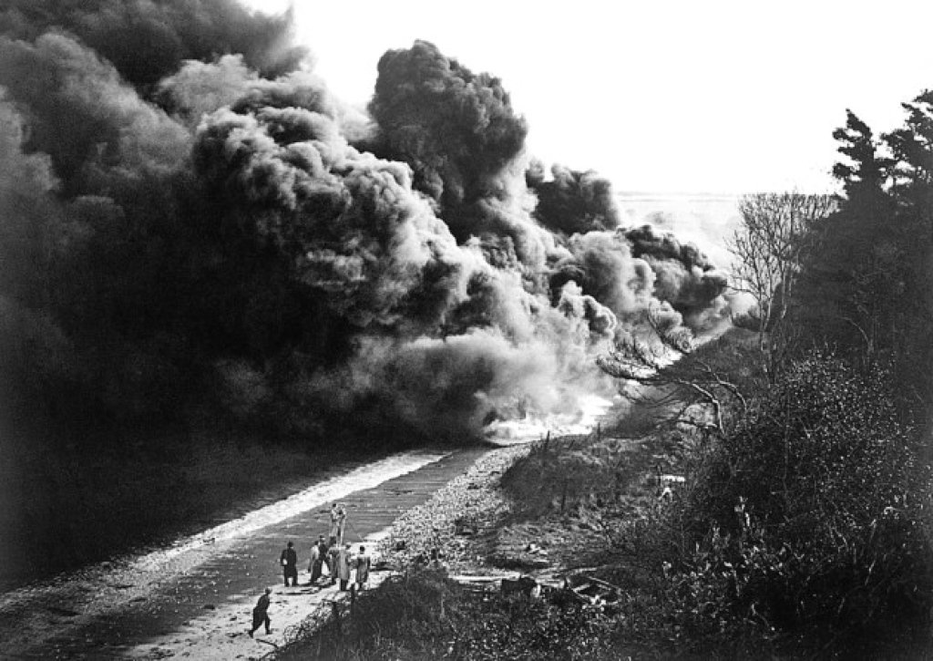 WWII black and white picture of shingle street suffolk, smoke going across beach
