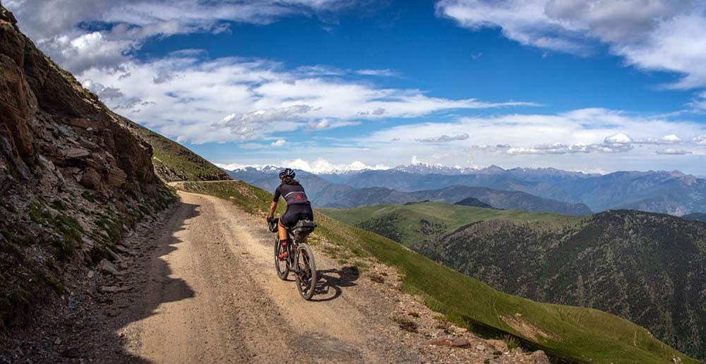 cyclist riding on old goat track across the Spanish Pyrenees