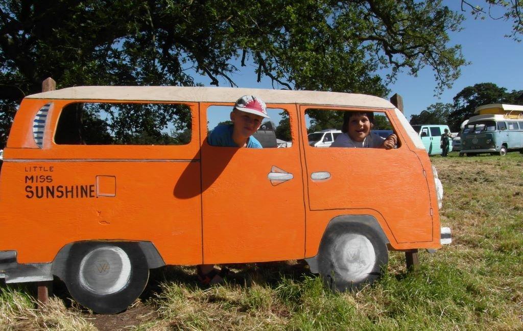 smiling kids in VW campervan