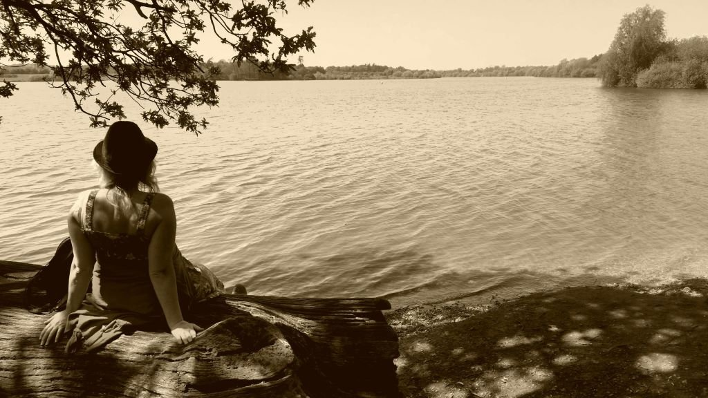 woman looking out across a lake