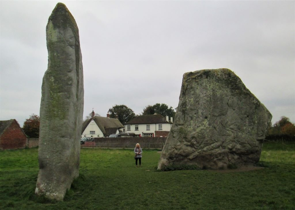 Hobo Trudi standing between two giant megaliths at Avebury stone circle