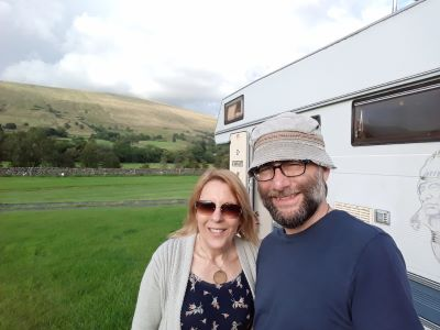 motorhome hobos next to their campervan